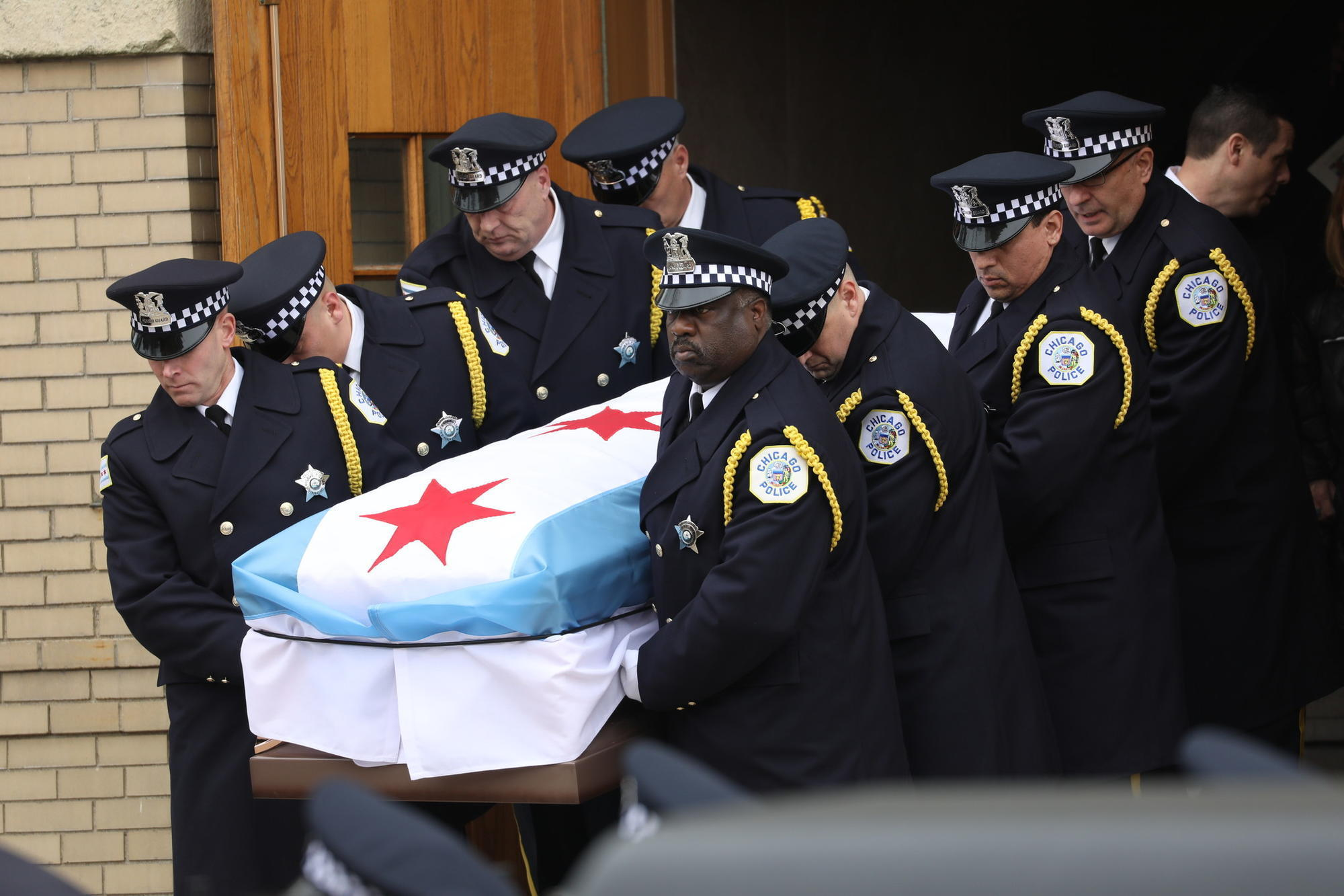 Slain Police Commander Laid To Rest With Stories Of