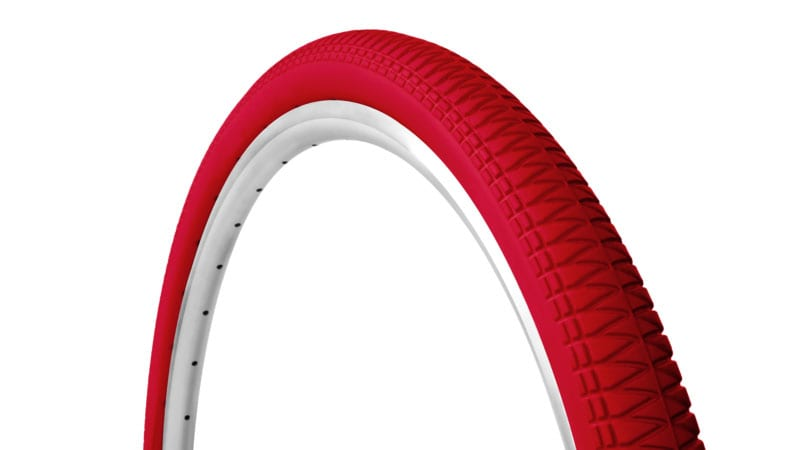45-degree angle red Tannus Razor Blade foam airless tire attached to rim showing moderate tread pattern