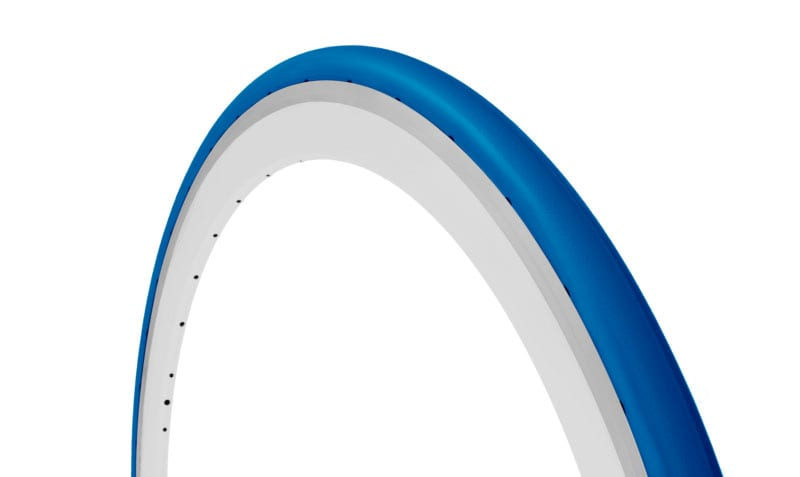 45-degree angle blue Tannus Slick foam airless tire attached to rim