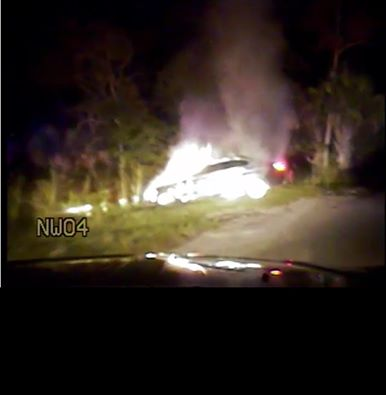 Deputy saves man from burning car