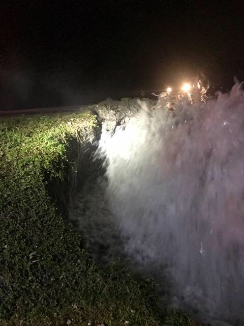 Fire hydrant bursts after it is hit by a car