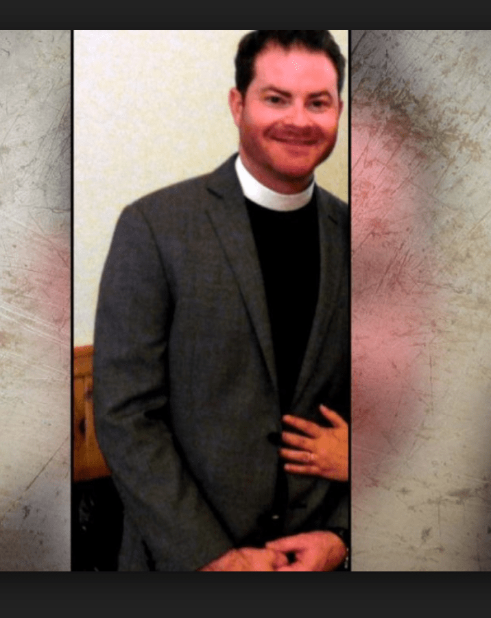 Priest charged in road rage
