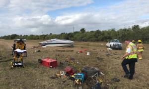 Truck hauling a boat rolls over on Turnpike