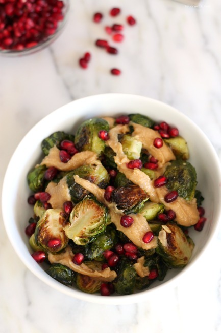 Roasted Brussels Sprouts with Pomegranates and Maple Tahini // treatswithatwist.com
