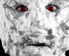 A picture of a face covered in shaving foam