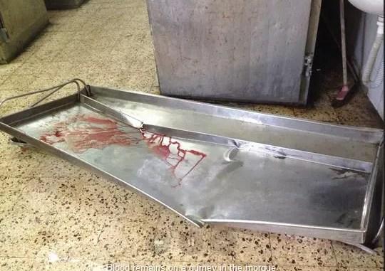 Gurney at Al Shifa hospital, Gaza, by Kerry Anne Mendoza