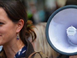 woman with megaphone, speaking, stammering