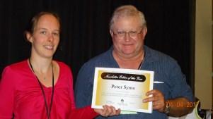 Annie receives newsletter award on behalf of Peter Syms