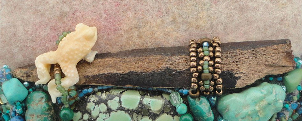 beaded ivory frog in a pond of turquoise and glass beads