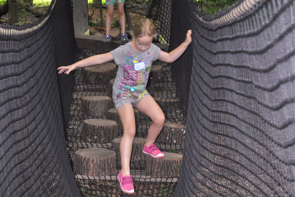 Girl on Obstacle Logs