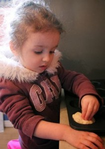 child learning to bake bread
