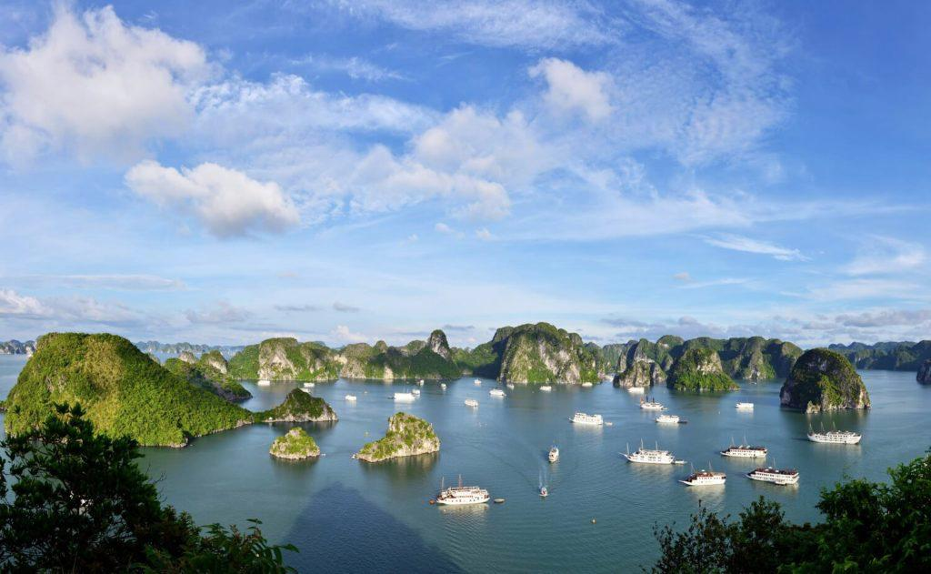 view of Halong Bay, one of the most beautiful places to visit in north vietnam, from above with many overnight cruises