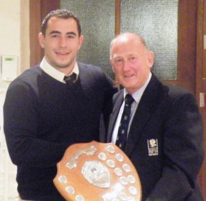 Lewis Paterson receives the Bill Osborne Shield from Peter Richmond