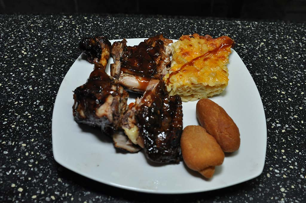 delicious order of bbq chicken, macaroni pie and festivals at trellis bay