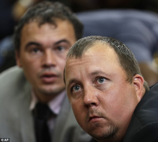 South African Farmers Willem Oosthuizen (left), 30, and Theo Jackson (right), 29, were sentenced for attempted murder, among other charges, after their attack on a black man which involved forcing him into a coffin