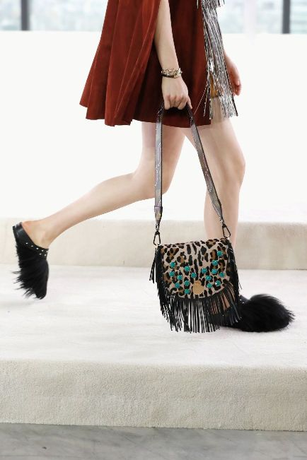 cf876ad0953 Bringing out the silhouettes' uniqueness and sensuality, brand new bag  lines like the Amazone are adorned with stones, twisted with contrasting  colorful ...