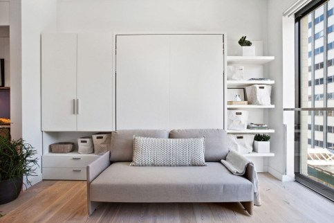 Contemporary Micro Apartment Organized With Boxes 10