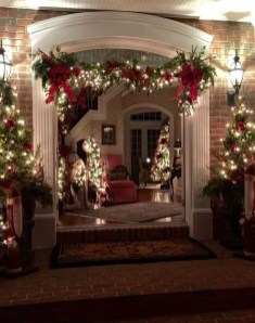 Adorable Front Door Christmas Decoration Ideas That Trend This Year 12