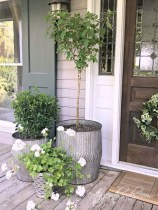 Adorable Porch Planter Ideas That Will Give A Unique Look08