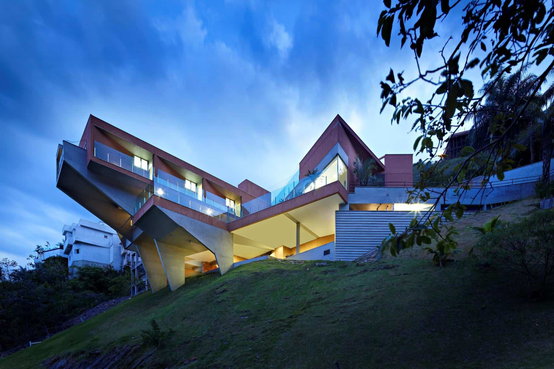 Sculptural Concrete House Built On A Steep Slope Modern House Designs