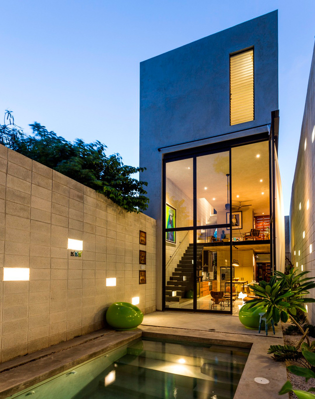 Skinny Concrete Home with Double Height Glass Doors ... on Glass House Design Ideas  id=70279