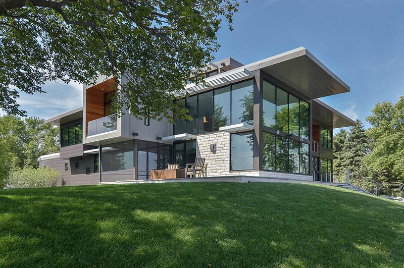Glass Lake House Features Modern Silhouette of Earthy ... on Modern Glass Houses  id=39500