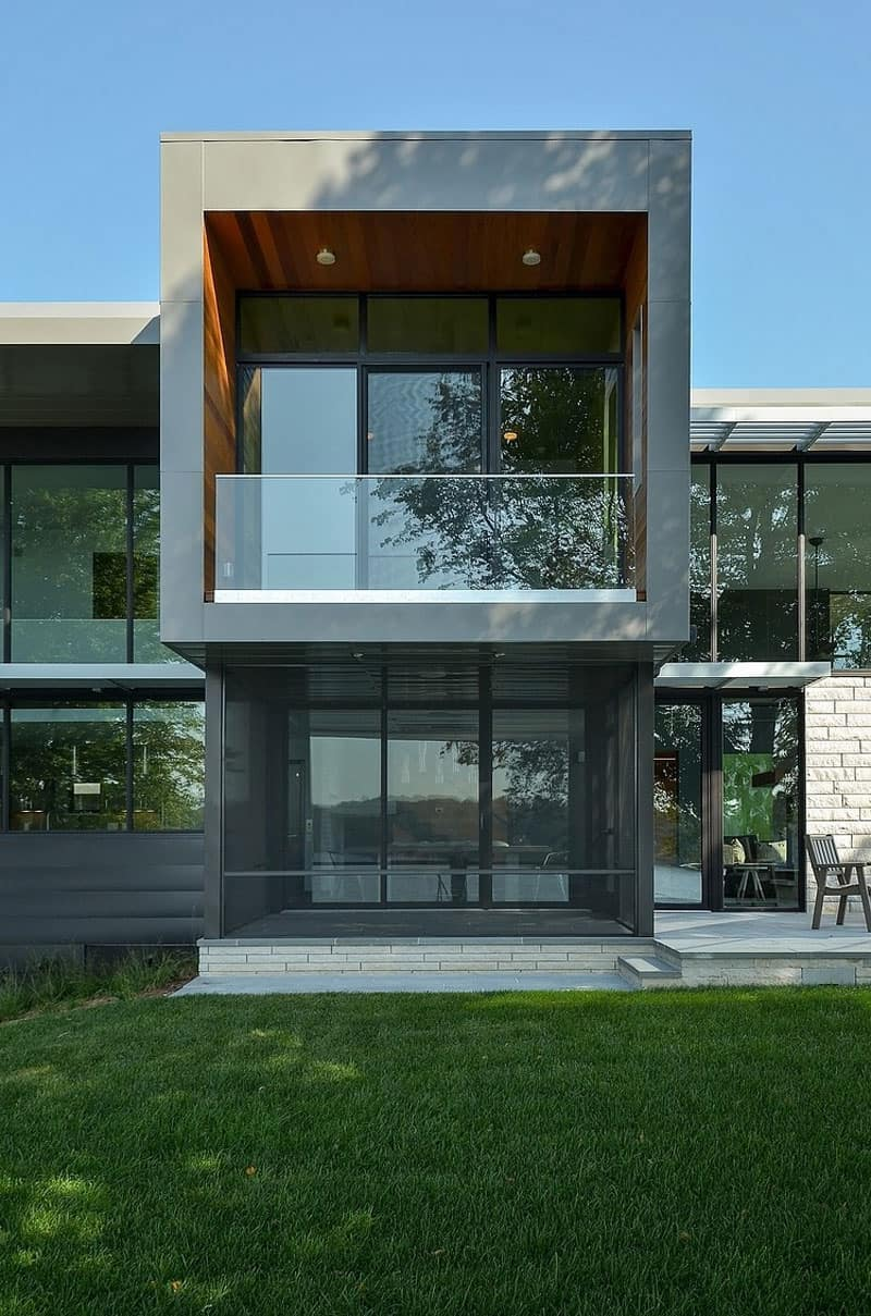 Glass Lake House Features Modern Silhouette of Earthy ... on Modern Glass Houses  id=49811