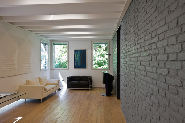 The Yellow Wall Creates A Warm Effect In This Gray Brick Homeu2026