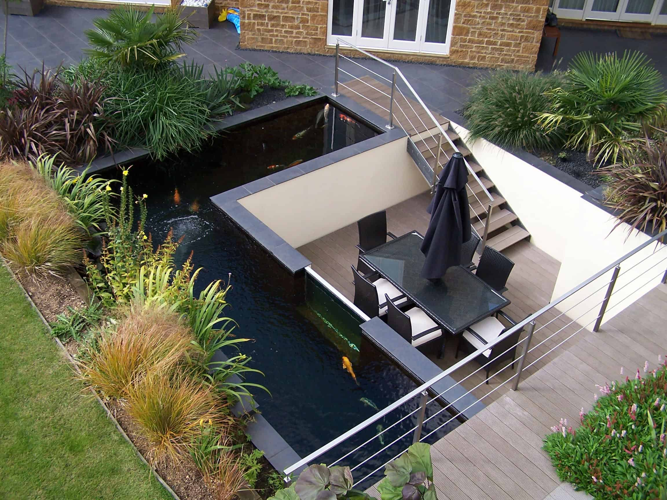 35 Sublime Koi Pond Designs and Water Garden Ideas for ... on Koi Ponds Ideas  id=29346