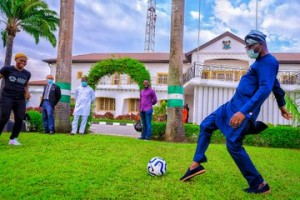 Governor Jide Sanwo-olu pictured playing football with Barcelona player, Asisat Ishoala