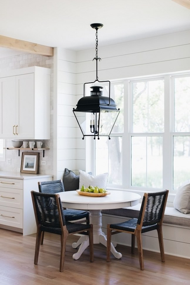 Modern farmhouse lighting fixture over dining table