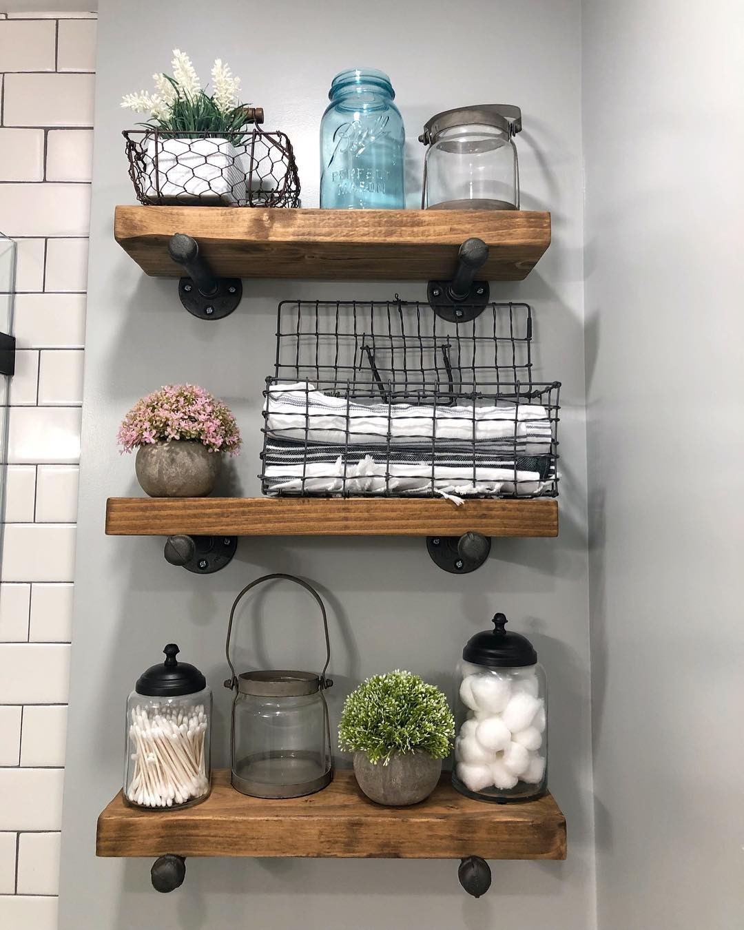 bathroom floating shelves with wire baskets