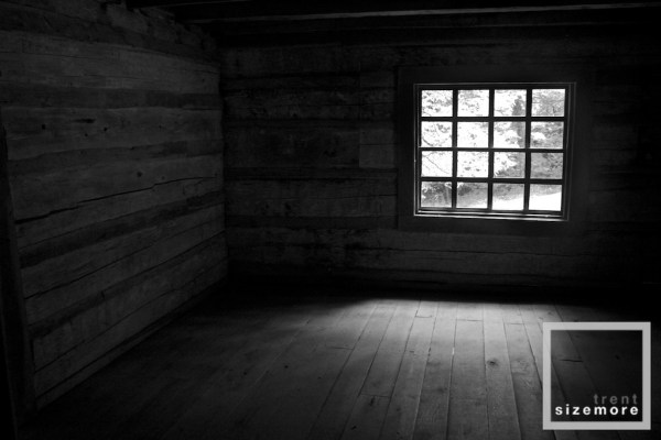 the principles of design in photography - contrast - a window inside an old cabin in the great smoky mountains national park