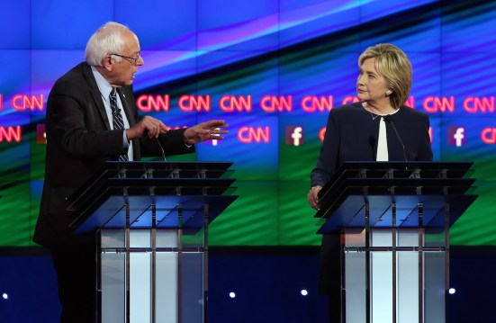 LAS VEGAS, NV - OCTOBER 13: Democratic presidential candidates Sen. Bernie Sanders (I-VT) (L) and Hillary Clinton take part in a presidential debate sponsored by CNN and Facebook at Wynn Las Vegas on October 13, 2015 in Las Vegas, Nevada. Five Democratic presidential candidates are participating in the party's first presidential debate. (Photo by Joe Raedle/Getty Images)