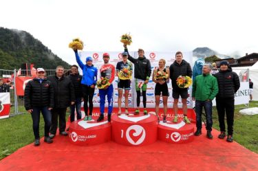 WALCHSEE, AUSTRIA - SEPTEMBER 03: Podium finishers pose for a photograph after the Challenge Walchsee-Kaiserwinkl Triathlon on September 3, 2017 in Walchsee, Austria. (Photo by Stephen Pond/Getty Images)