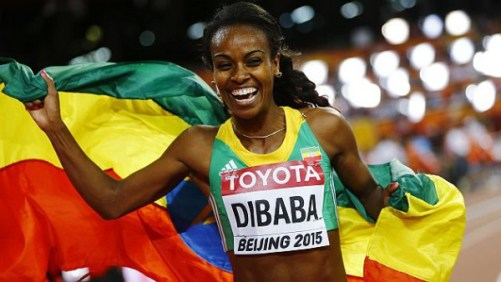 Genzebe Dibaba of Ethiopia holds her national flag after winning the women's 1500 metres final at the 15th IAAF World Championships at the National Stadium in Beijing, China August 25, 2015.     REUTERS/Kai Pfaffenbach