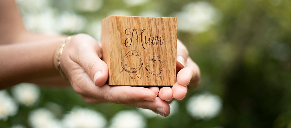 Ashes can be safely stored in this wooden keepsake candle which can be personalised with engraving. Keepsake ashes size.