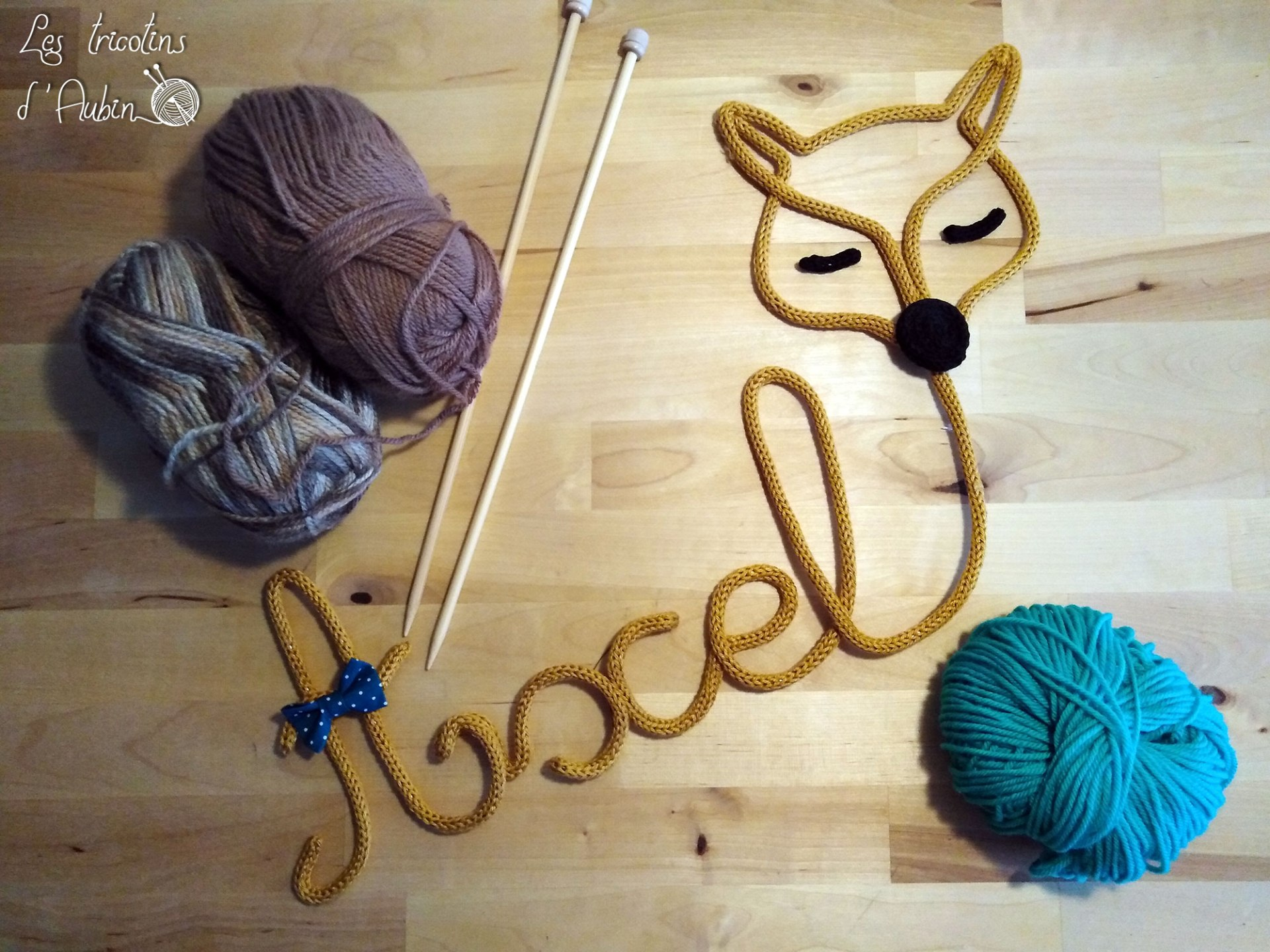 Axel et tête de renard tricotin