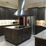 Standout stone and custom cabinetry combine for a winning Pearland kitchen remodel