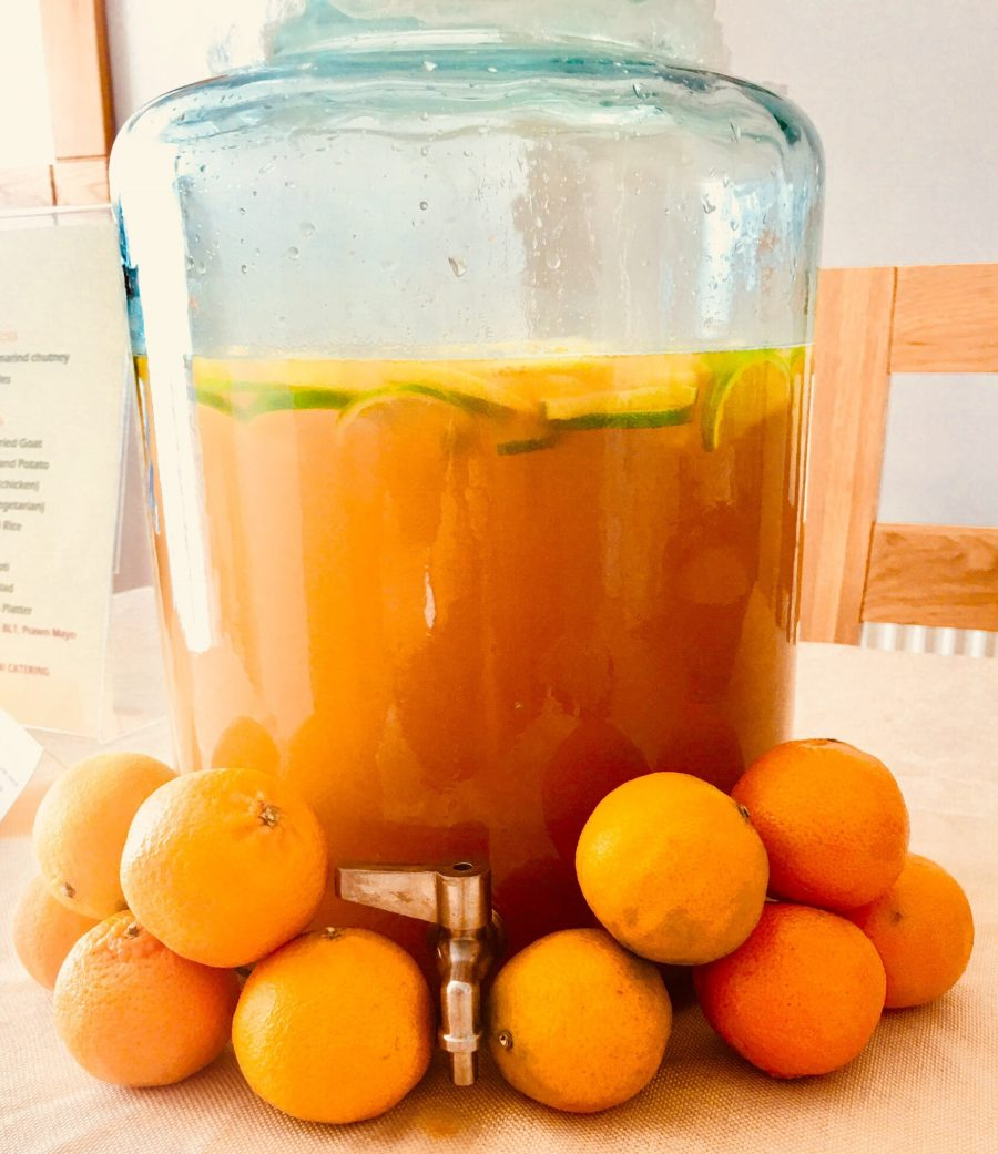 Caribbean Rum Punch in a large glass jar ready to serve