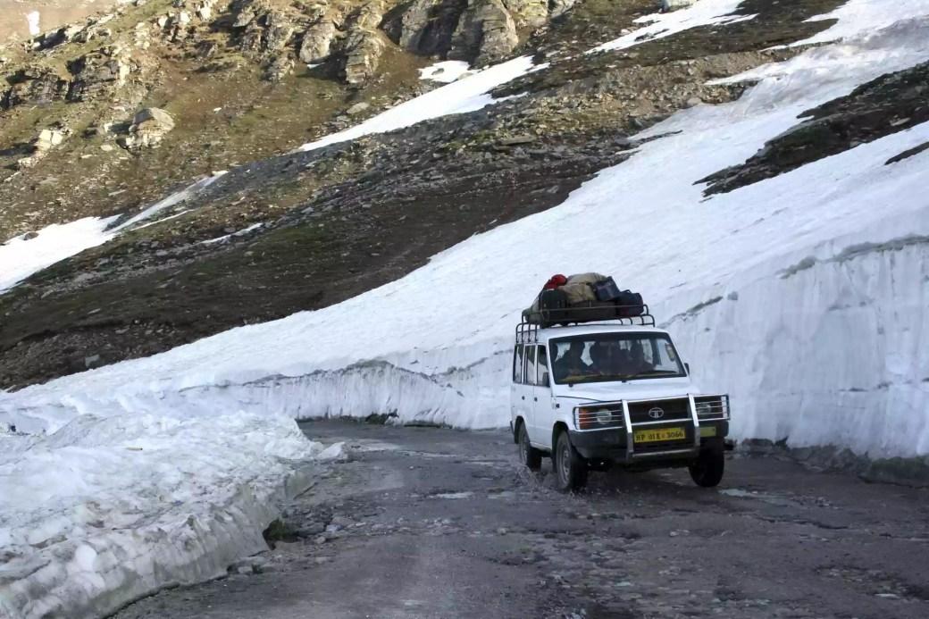 Tourist jeep passing through Rohtang Pass in Manali, Himachal Pradesh, India