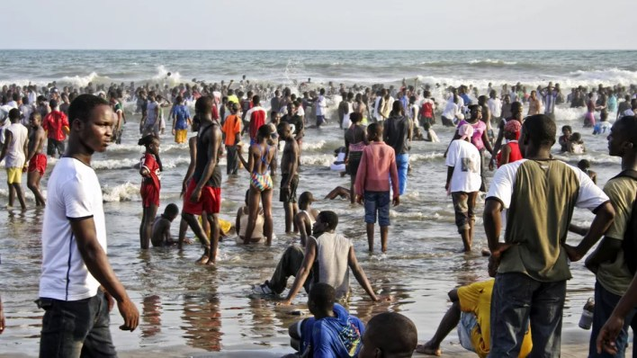 Crowded African city beach.