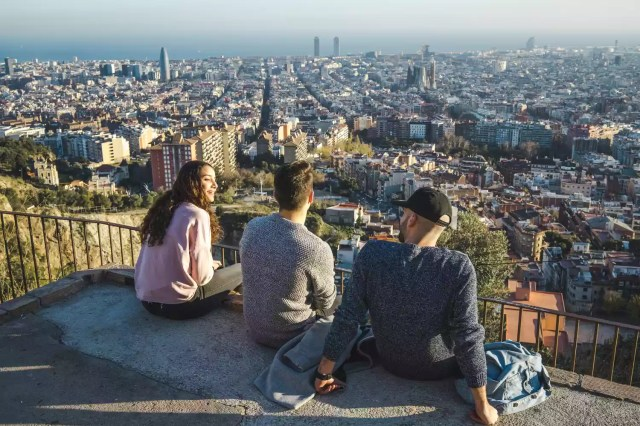 Group of people enjoying the skyline views of Barcelona, Spain