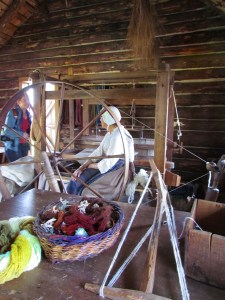 Spinning wheel and Gaelic housewife at the Highland Museum explaining the spinning and dye technique of the old Scottish settlers.