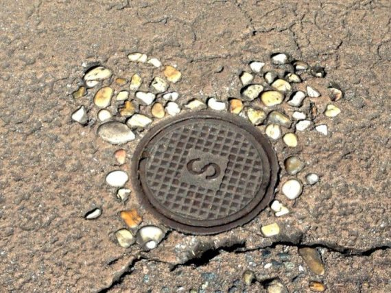 We had a guide book that revealed hidden secrets around Walt Disney World and I wouldn't have noticed this one hidden Mickey unless one of the cast members hadn't pointed out the stones embedded in the sidewalk around a little metal sewer cover. Those Mickeys!!