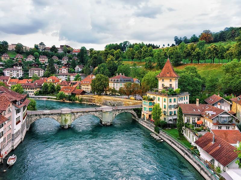 Unterbrucke bridge over Aare River and old houses in Bern Switzerland.