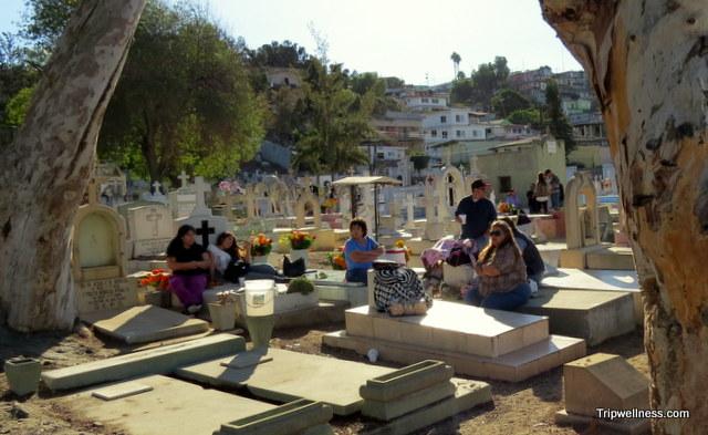 Family gathers inside the Puerta Blanca Cemetery, Tijuana