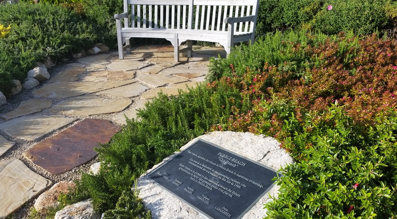The bench and plaque commemorating American ownership of the Pebble Beach Golf Resort