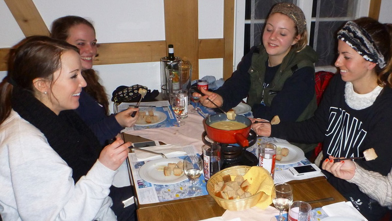 A fondue dinner after night sledding with Outdoor Interlaken