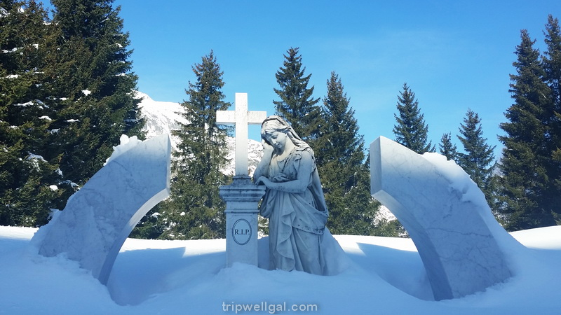 An angel in the snowy graveyard at the Church